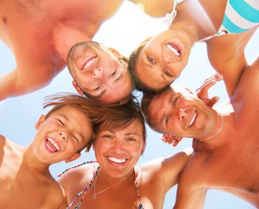 Family with bright white teeth on Orange Beach
